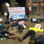 This is an emergency: Extinction Rebellion stage die-in on campus