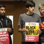 Students clash over strike action and racist incident