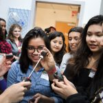 Does language used for encouragement influence girls' engagement in science?